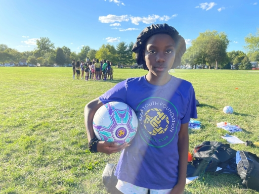 Sarah Ngandu poses seriously for her first photo as captain of her soccer team. She wasn't expecting to get all of the votes that she did.