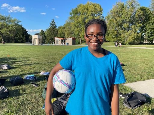 Nadege Lenge, 11, poses with her soccer ball