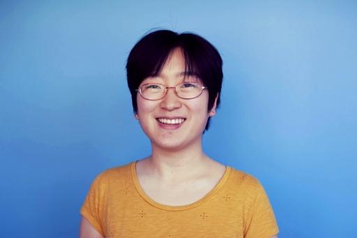 Portrait of woman against blue backdrop
