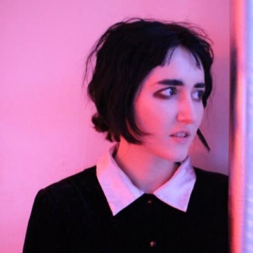 Portrait of woman in pink light