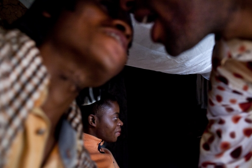 """[""""<p>Members of Rainbow Sunrise kiss to greet each other as they meet at their friend's house in Bukavu, Democratic Republic of Congo.</p>\n""""]"""