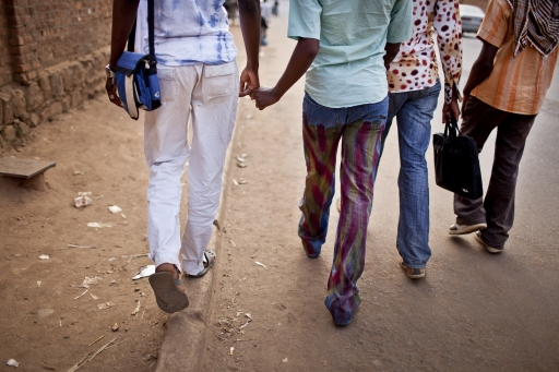 "[""<p>Members of Rainbow Sunrise touch hands as they walk together on the streets of Bukavu, Democratic Republic of Congo. </p>\n""]"