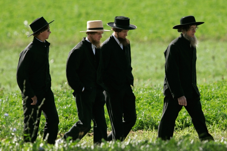 <p>Four Amish men walk to a funeral for a victim of the Amish schoolhouse shootings October 5, 2006 in Nickel Mines, Pennsylvania.</p>