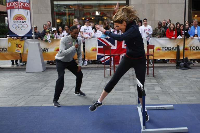<p>Today Show co-host Natalie Morales tries to jump a hurdle with Olympic athlete Jason Richardson during a 100 Days to the London Olympics celebration today in New York City.</p>