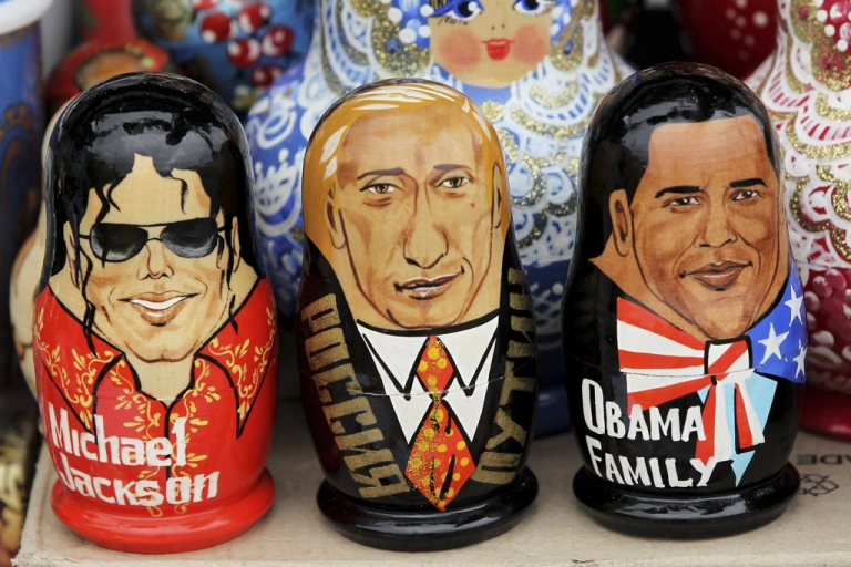 <p>Matryoshka dolls in the likeness of late singer Michael Jackson, Russian Prime Minister Vladimir Putin and U.S. President Barack Obama stand on display at in St. Petersburg, Russia. Obama is finally calling to congratulate Putin on his recent election win, which international observers say is shadowed in fraud.</p>