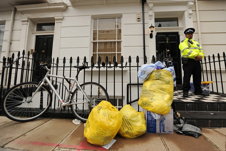 <p>A police officer stands guard outside of the entrance to a flat in central London shortly after the body of Gareth Williams was discovered on August 26, 2010.</p>