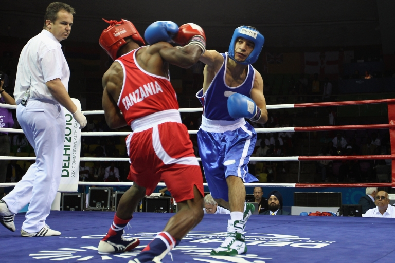 <p>Pakistan Boxer Mohammad Waseem participates at the 52kg Fly weight division at the Talkatora Indoor Stadium during day two of the Delhi 2010 Commonwealth Games on October 5, 2010 in Delhi, India.</p>