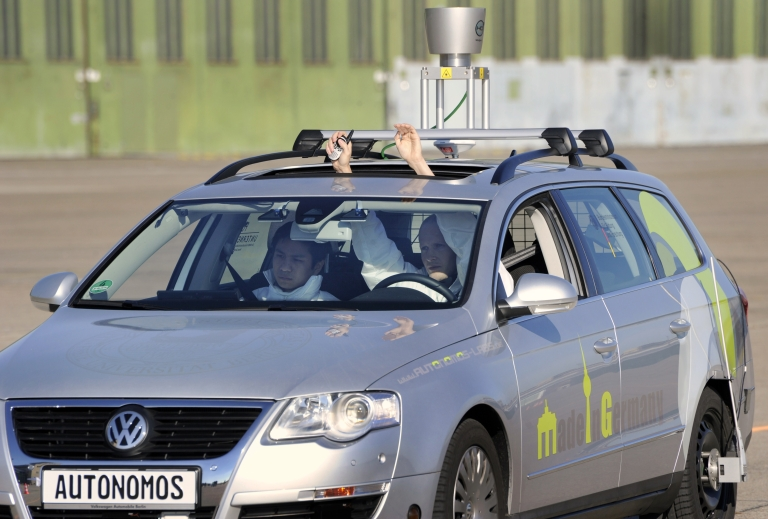 <p>A technology group says that cars will be driving themselves by 2040. Above, a driverless car 'Made in Germany' (MIG), which from the outside looks like a regular Volkswagen Passat with a camera on top, is being put through its paces at Berlin's disused Tempelhof airport.</p>