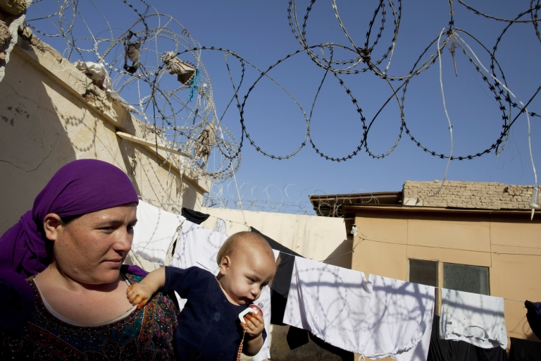 <p>Ahsa Gul holds her son Sayed,11 months, inside the women's prison in Mazar-e-Sharif, Afghanistan on October 22, 2010. According to Afghanistan's Ministry for Women and the Independent Human Rights Commission, many women there are incarcerated are detained for