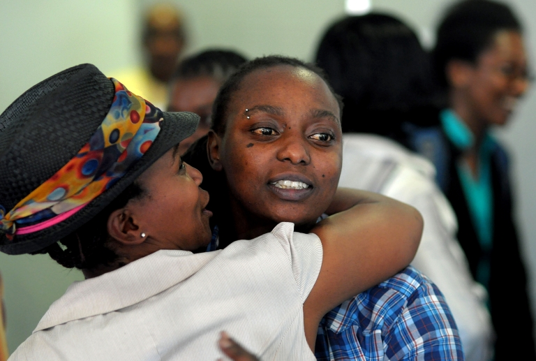 <p>Two delegates greet one another at an international conference on sexual orientation, gender identity and human rights in on November 15, 2010 in Cape Town, South Africa. The conference focused on the challenges faced by the lesbian, gay, bisexual and transgender (LGBT) communities in Africa.</p>