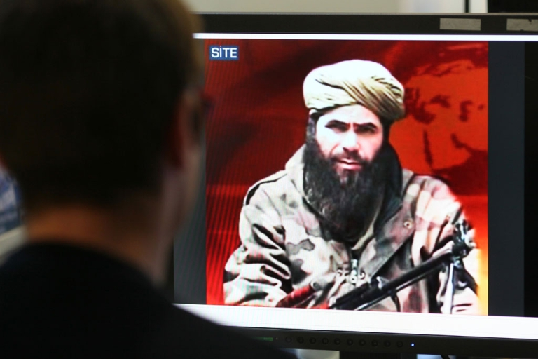 <p>A man looks at a picture of Abdelmalek Droukdel, aka Abou Moussab Abdelwadoud, leader of Al-Qaeda in the Islamic Maghreb (AQIM). The group claimed to have kidnapped a German engineer working in Nigeria.</p>