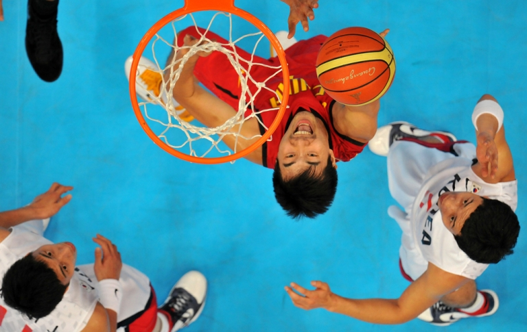 <p>Wang Shipeng of China  shoots against South Korea during the men's gold medal basketball game against South Korea at the Guangzhou international sport arena during the 16th Asian Games on November 26, 2010.</p>