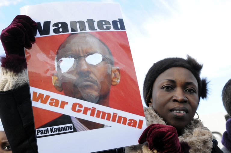 <p>A demonstrator holds a poster showing Rawanda's President Paul Kagame in Brussels. South Africa is charging that Kagame's government sent agents to South Africa to assassinate a Rwandan critic of Kagame who has political asylum in South Africa.</p>