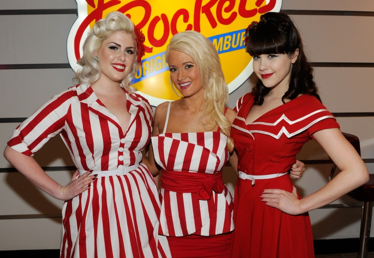 <p>Claire Sinclair (R) appears with Playboy models Doris Mayday Holly Madison in Bettie Page style dress at Johnny Rockets at the Flamingo Las Vegas to celebrate the restaurant's grand opening December 10, 2010 in Las Vegas, Nevada.</p>