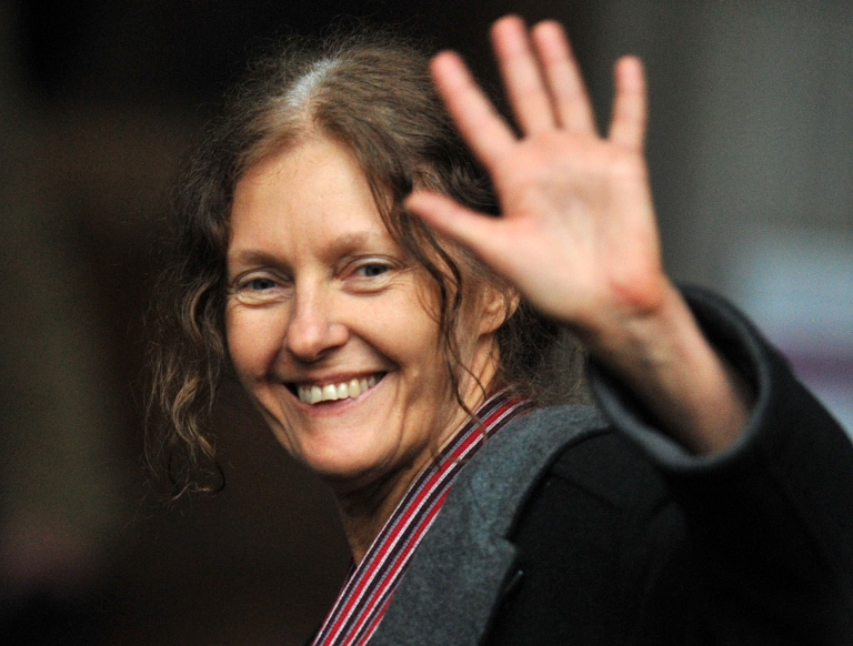 <p>Christine Assange, mother of WikiLeaks founder Julian Assange, smiles and waves after addressing the media outside the High Court in central London, on December 16, 2010.</p>