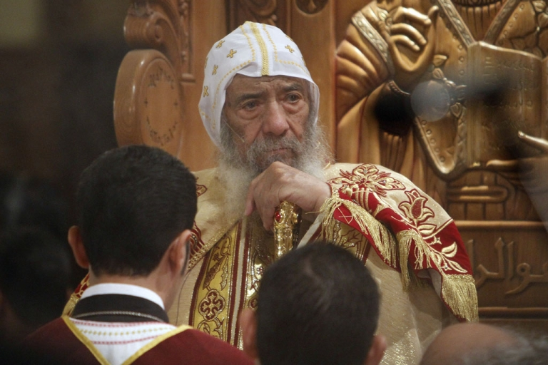 <p>Pope Shenouda III, head of the Egyptian Coptic Orthodox Church, leads Christmas mass in Abassiya Cathedral in Cairo on Jan. 6, 2011.</p>