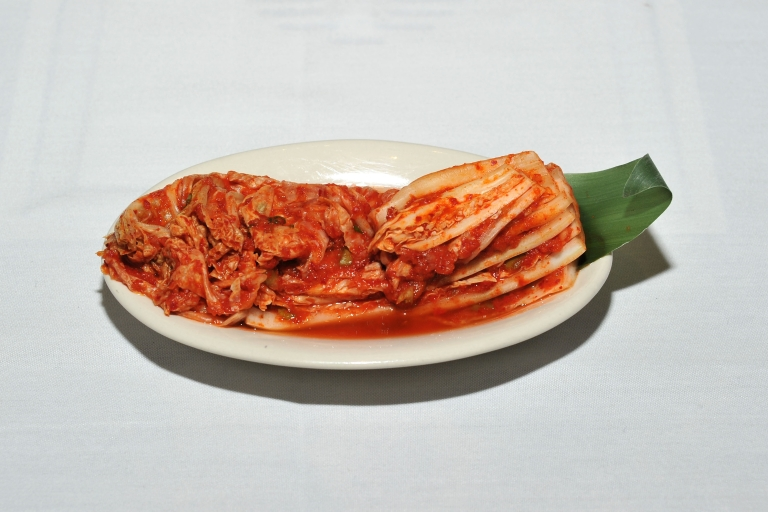 <p>Kimchi is a traditional Korean dish of spicy fermented cabbage and radish.</p>