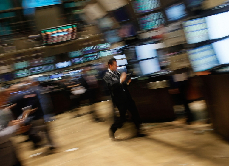 <p>A financial professional races by on the floor of the New York Stock Exchage at the end of the trading day March 3, 2011 in New York City.</p>
