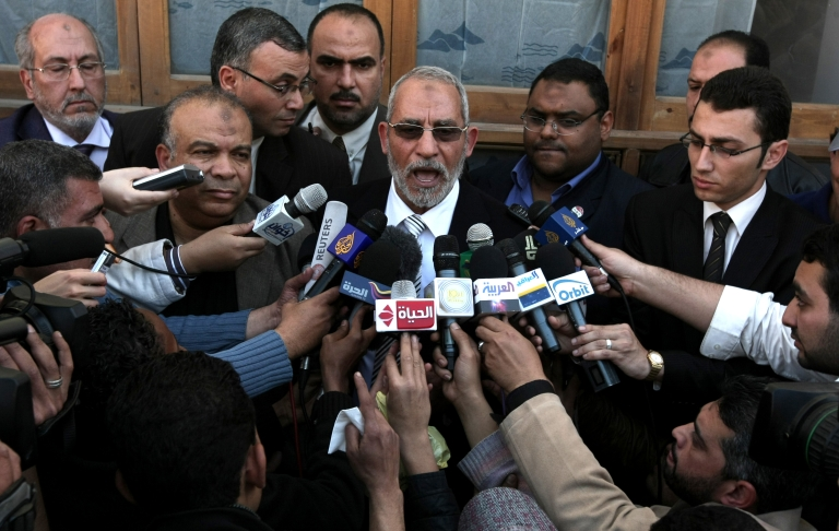 <p>Mohammed Badie, the head of Egypt's Muslim Brotherhood speaks to the press outside a polling station in Cairo on March 19, 2011 as voters got their first taste of democracy in a referendum to a package of constitutional changes after president Hosni Mubarak was forced to relinquish his 30-year grip on power in the face of mass street protests.</p>