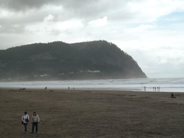 <p>People stroll on the misty beach of Seaside, Oregon, on March 19, 2011.</p>
