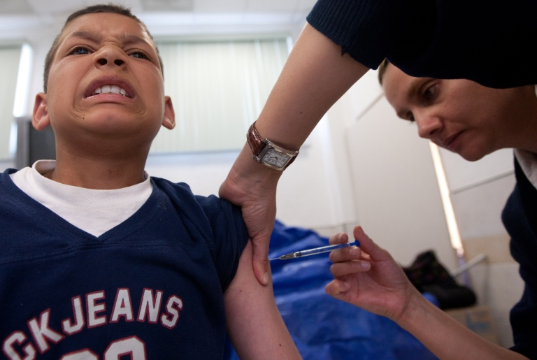 <p>A boy is vaccinated during a day of the vaccination campaign against Influenza.</p>