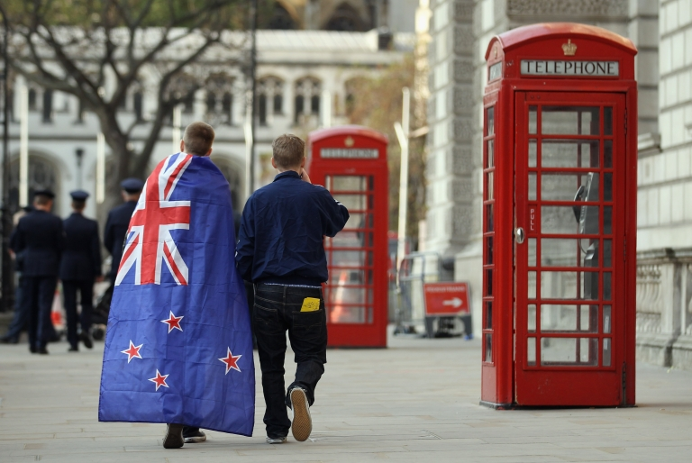 <p>Two young men leave, one wearing a New Zealand flag — which looks almost exactly like the Australian flag —after a service of remembrance at the Cenotaph on Whitehall on April 25, 2011 in London, England.</p>