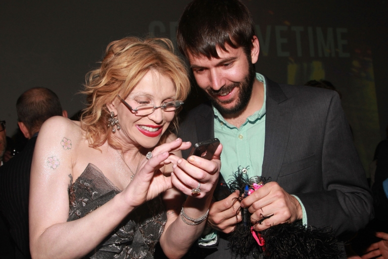 <p>Courtney Love shares a photo on her iPhone with a reporter on May 5, 2011 in New York City. Apple unveiled its iPhone 4s on Oct. 4.</p>