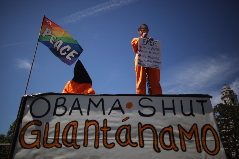 <p>Protesters stage a demonstration against US policy at Guantanamo Bay detention camp.</p>