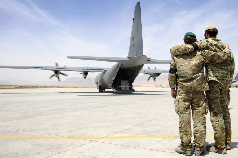 <p>Two special forces soldiers embrace as the C-130 carrying Sergeant Brett Wood,who was killed in action,  departs Tarin Kot Airfield, Saturday, May 28, 2011, in Uruzgan, Afghanistan.  32 Australian soldiers have been killed in Afghanistan since 2001.</p>