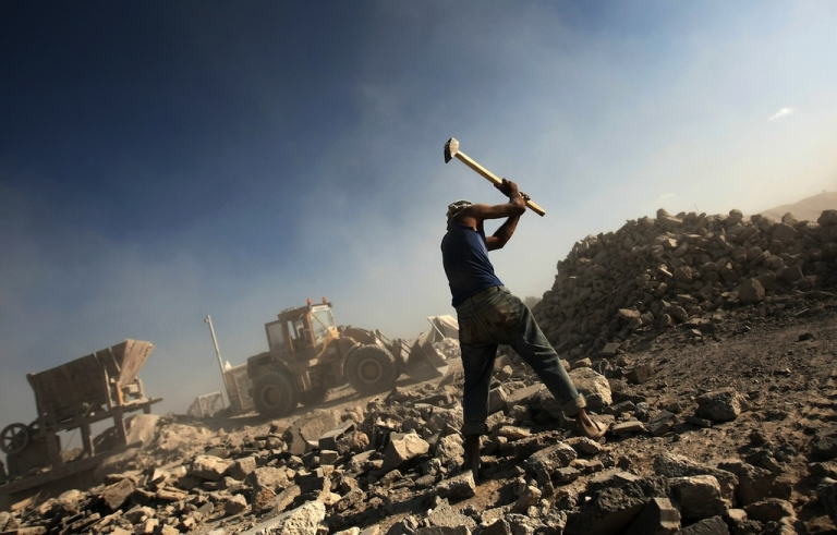<p>A Palestinian laborer works at a factory recycling the ruins of houses in order to use them in new construction sites in Gaza City on June 1, 2011.</p>