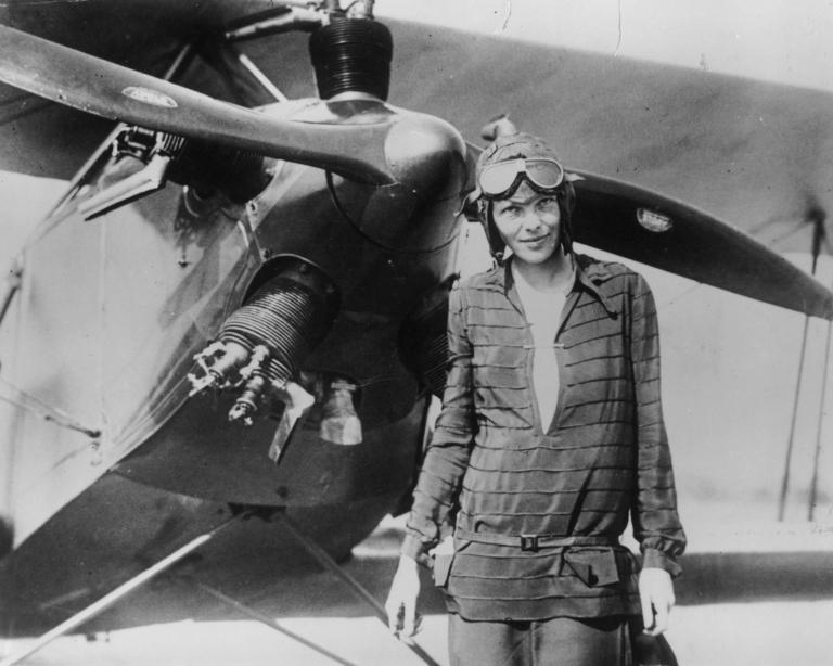 <p>Amelia Earhart stands June 14, 1928 in front of her bi-plane called