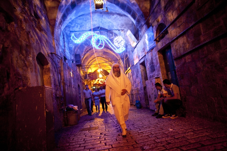 <p>A Palestinian man walks towards the Damascus gate during the Jerusalem Festival of Lights on June 15, 2011 at Jerusalem's Old City, Israel. The festival opened on Wednesday night and will run for a week in the Old City of Jerusalem, hosting Israeli and international artists and creators who will display their installations throughout the week.</p>