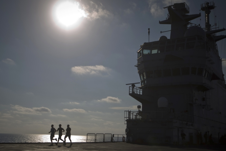 <p>French soldiers are jogging on the French amphibious assault helicopter carrier