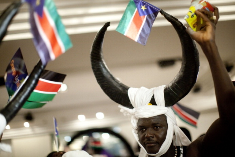 <p>A man wearing a headress dances as Sudanese refugees living in Tel Aviv celebrate independence from the Republic of Sudan on July 10, 2011 in Tel Aviv, Israel. Israel's Prime Minister Benjamin Netanyahu announced that Israel recognizes the Republic of South Sudan as independent state. South Sudan became a state on July 9 after it separated from the north, with its capital in Juba, following a vote for independence. The country was recognized on July 8 by the government of Sudan.</p>