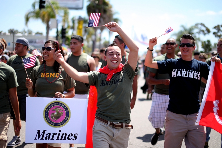 <p>Marine Jaime Rincon marches down University Avenue, with other military personel, during the San Diego Gay Pride Parade on Saturday, July 16, 2011 in San Diego, California.</p>