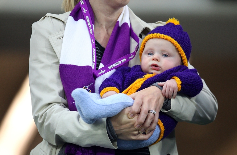 <p>An Australian mother holds her child in Melbourne, Australia, Aug. 6, 2011.</p>