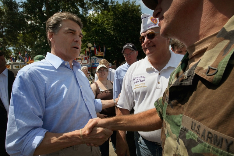 <p>Republican presidential candidate and Texas Governor Rick Perry greets visitors at the Iowa State Fair August 15, 2011 in Des Moines, Iowa.</p>