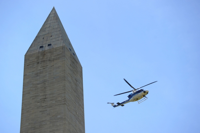 <p>A Parks Police helicopter inspects the Washington Monument shortly after an earthquake struck Washington, DC August 23, 2011. One of the strongest earthquakes to strike the U.S. east coast in decades rattled offices Tuesday in downtown Washington and caused panicked evacuations from skyscrapers as far away as New York. The Pentagon, the US Capitol and Union Station in the nation's capital were all evacuated after the 5.9-magnitude quake, which was shallow with its epicenter only 0.6 miles (one kilometer) underground.</p>