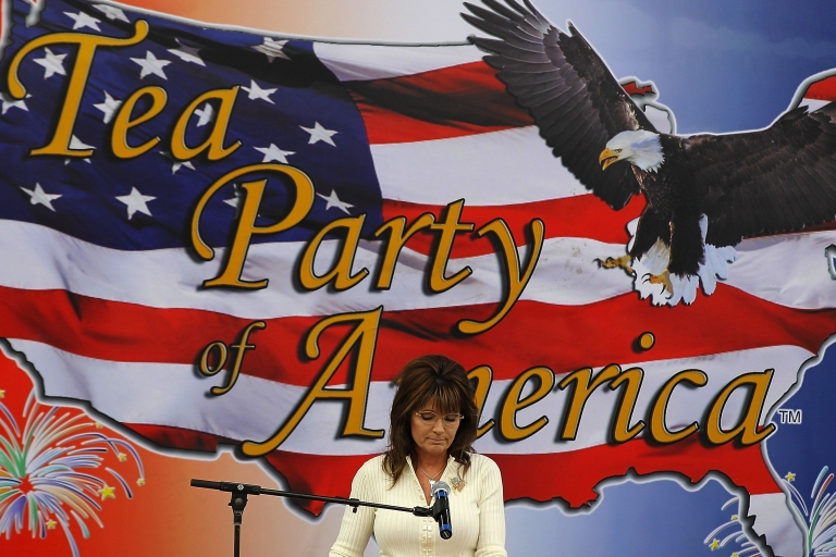 <p>Former Alaska governor Sarah Palin pauses as she speaks during the Tea Party of America's