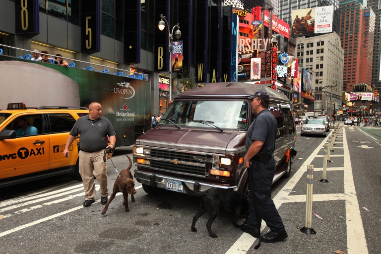 <p>New York Police Department Bomb Squad detectives and K9 dogs investigate a vehicle after it was parked near Times Square with its headlights on, September 10, 2011 in New York City.</p>