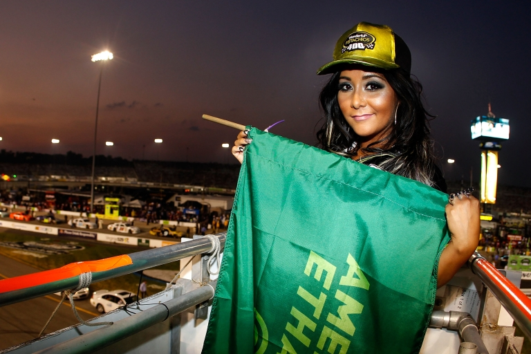 <p>TV personality Nicole 'Snookie' Polizzi poses with the green flag prior to the NASCAR Sprint Cup Series Wonderful Pistachios 400 at Richmond International Raceway on September 10, 2011 in Richmond, Virginia.</p>