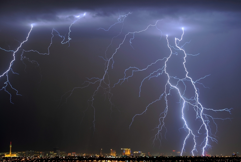 <p>Lightning flashes during a thunderstorm early on September 13, 2011 in Las Vegas, Nevada. Americans increasingly believe that unusual weather is due to climate change.</p>