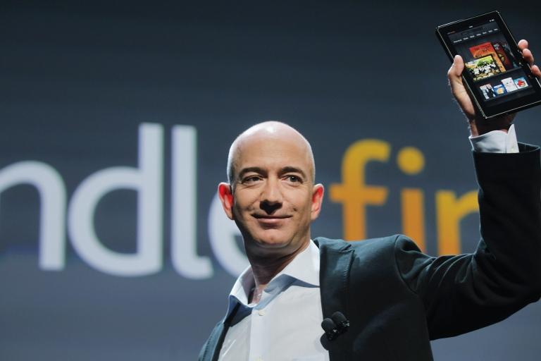 <p>Amazon founder Jeff Bezos holds the tablet computer Kindle Fire on September 28, 2011 in New York City.</p>