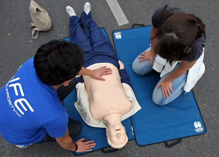 <p>A woman takes a brief CPR course during an outdoor festival to celebrate German Unity Day on the 21st anniversary of German reunification on October 3, 2011 in Berlin, Germany.</p>