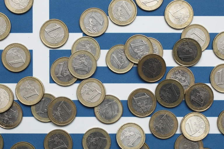 <p>In this photo illustration a Greek flag is covered with one Euro coins on October 4, 2011 in Berlin, Germany.</p>