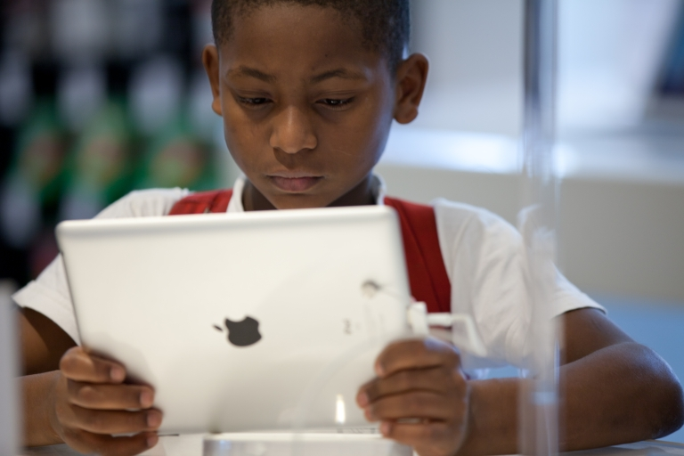 <p>A Brazilian boy looks at an iPad at the retail shop of Apple products in Sao Paulo.</p>
