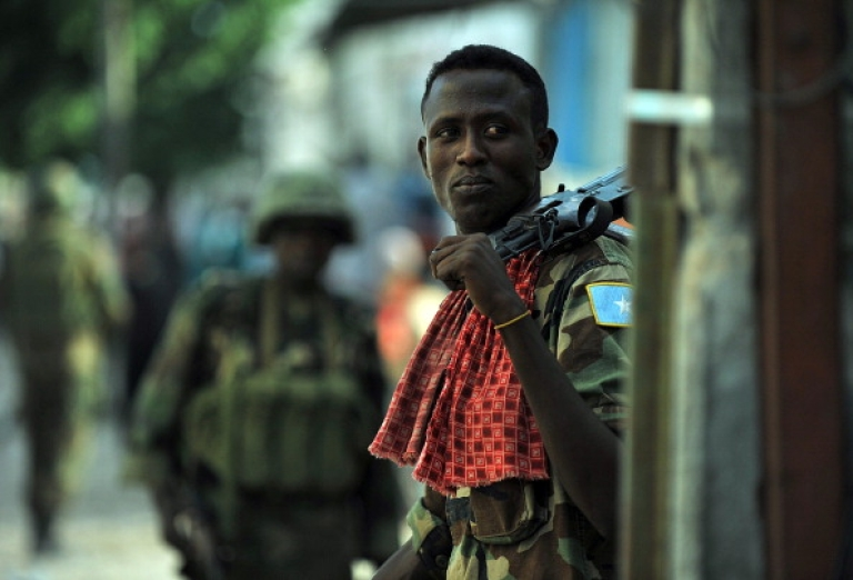 <p>Somalia's violence and instability have spilled over into Kenya. Here a soldier of Somalia's Transitional Federal Government patrols the Somalia capital, Mogadishu.</p>