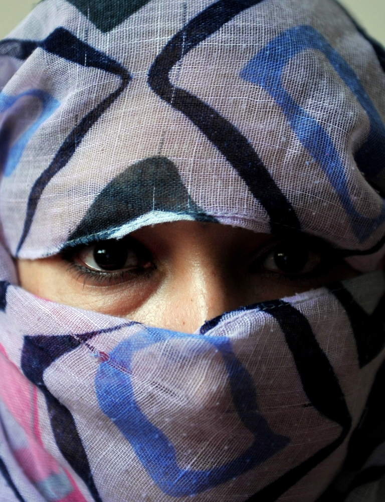 <p>Shafiyah, 27, released from prison after three years in jail, poses for a portrait at a shelter run by women for Afghan women in Kabul on October 12, 2011. Shafiyah was arrested by police and imprisoned after fleeing from her husband who became a beggar after the Taliban government was ousted from power.</p>