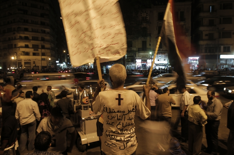 <p>Nearly 3,000 Egyptian mourners gather in in Cairo's Tahrir Square on October 15, 2011 for a candlelight vigil in honor of Coptic Christians among 27 people killed during a demonstration over an attack on a church. Egypt's ruling military approved on October 15 a law to punish discrimination.</p>