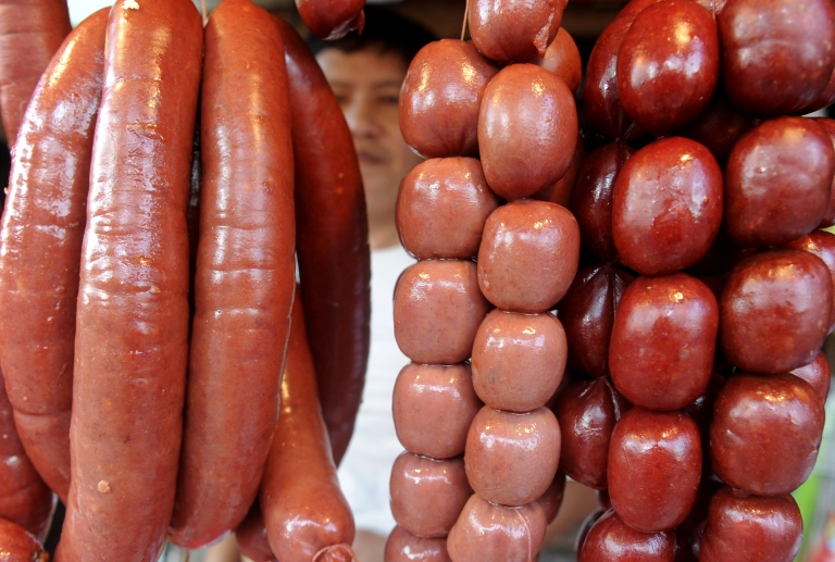 <p>Sausages are displayed for sale at a stall in Manila on October 16, 2011.</p>